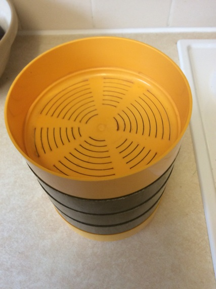 The top tray is ventilated to allow air to circulate